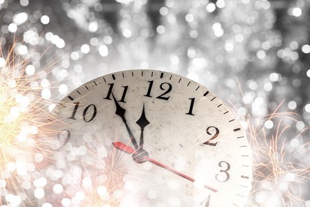 twelve month old: Clock in bokeh lights showing almost midnight Stock Photo