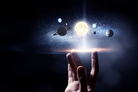 system: Male hand touching with finger image of sun system planets