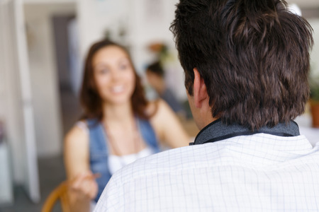 attractive  female: Smiling young designer in office talking to her colleague