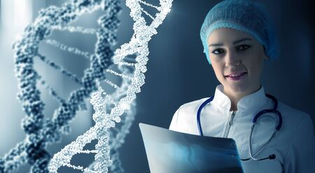 nucleotides: Woman scientist at media background of DNA molecule