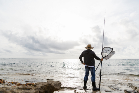 botas altas: Picture of fisherman fishing with rods