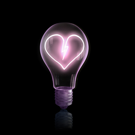 heart intelligence: Glass light bulb with power sign inside on black background