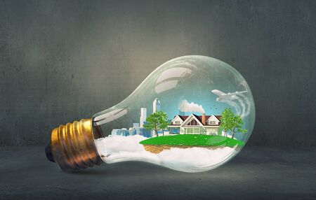 rural development: Think green concept with modern cityscape inside of light bulb Stock Photo