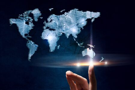 high tech world: Hand of person touching digital world map image