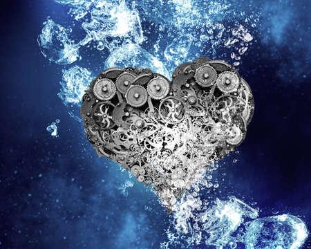 heart gear: Gear heart sink in clear blue water Stock Photo