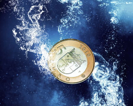 clear: Five euro coin in clear blue water Stock Photo