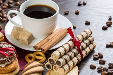 biscuit: Assorted biscuits and sweets with a cup of coffee on table Stock Photo