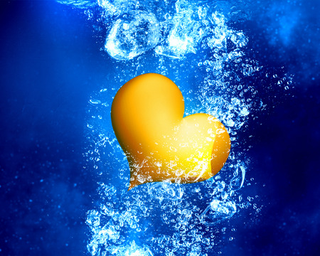heart under: Yellow love heart under clear blue water