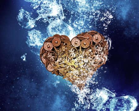 clear: Gear heart sink in clear blue water Stock Photo