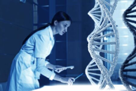 nucleotides: Woman scientist examining DNA molecule image at media screen Stock Photo