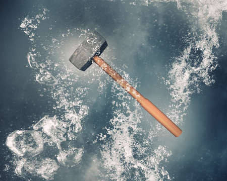 clear: Hammer instrument sinking in clear blue water