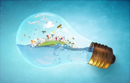Glass light bulb with water and city island floating inside