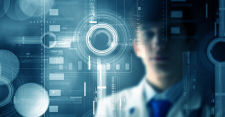telecommunicate: Young thoughtful doctor looking at media virtual screen