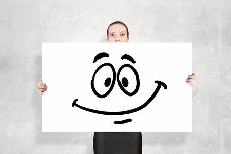 hidden success: Businesswoman showing white banner with smile emoticon