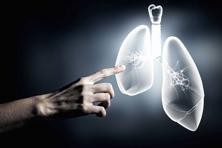 bronchiolar: Close up of hand touching lungs sign