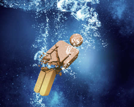 male figure: Male figure sinking and dissolving in clear blue water