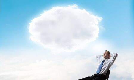 thought cloud: Businessman in chair and blank thought cloud above his head