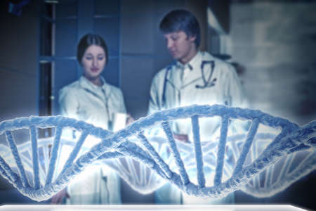 nucleotides: Young scientists looking at DNA molecule image at media screen