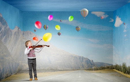 fiddlestick: Portrait of cute preschooler boy playing his violin Stock Photo