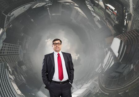 hands on pockets: Experienced businessman in glasses standing with hands in pockets