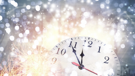 12 month old: Clock in bokeh lights showing almost midnight Stock Photo
