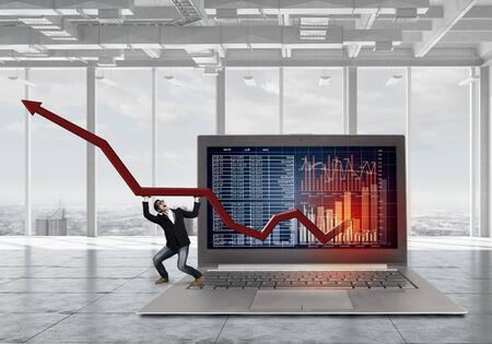 average guy: Young businessman on huge laptop making red arrow graph grow