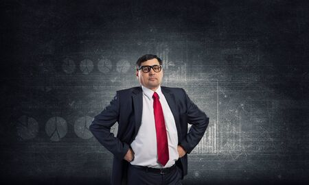 hands on waist: Confident businessman posing with hands on his waist