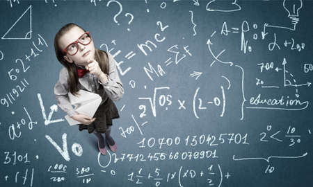 wideangle: Wideangle picture of funny schoolgirl with paper plane in hand Stock Photo