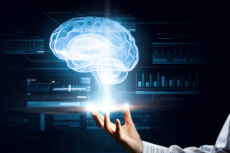 holography: Close up of male hand presenting holography of brain in palm