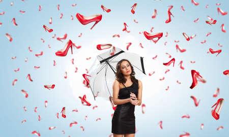sotto la pioggia: Beautiful young woman with umbrella under rain of shoes Archivio Fotografico
