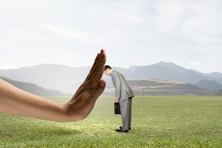 hand on forehead: Frustrated businessman leaning with forehead on human hand