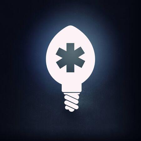 cross light: Cross light bulb glowing icon on dark background