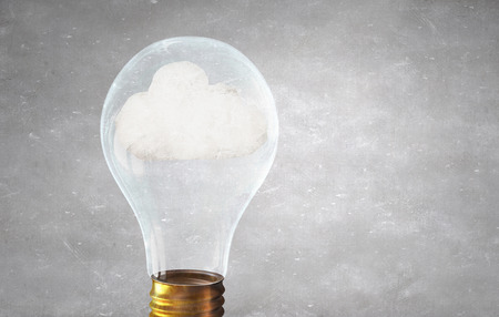 close fitting: Close up of glass light bulb with cloud inside Stock Photo