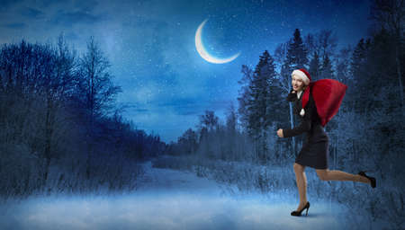 express positivity: Santa woman running with red gift bag on back