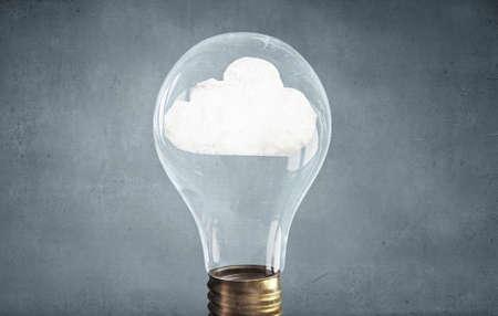 kilowatt: Close up of glass light bulb with cloud inside Stock Photo
