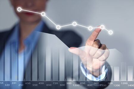 sales growth: Close view of businesswoman touching with finger on screen market infographs Stock Photo