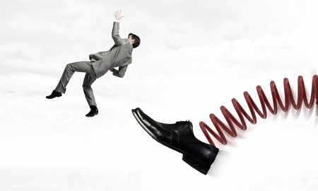 reprimand: Businessman kicked by his boss foot on spring
