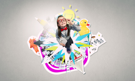 wideangle: Wideangle picture of funny schoolgirl with paper plane
