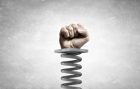 suddenness: Fist on spring as power and suddenness concept Stock Photo