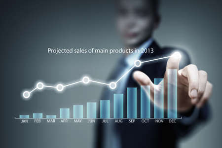 average guy: Close view of businessman touching with finger on screen market infographs
