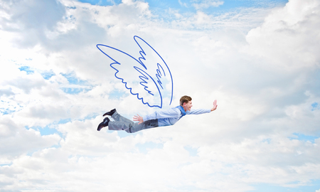 business challenge: Cheerful businessman with drawn wings flying in sky Stock Photo