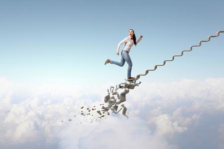collapsing: Young woman walking up collapsing staircase representing success concept