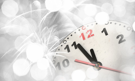 '5 december': Clock in bokeh lights showing almost midnight Stock Photo