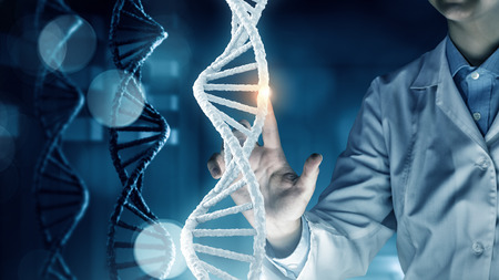 mutation: Woman scientist touching DNA molecule image at media screen