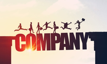 collectives: Silhouettes of businesspeople jumping over business conceptual word Stock Photo