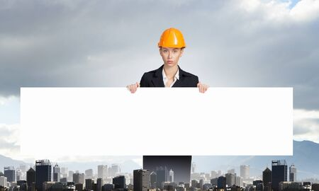 woman engineer: Attractive woman engineer holding white blank banner