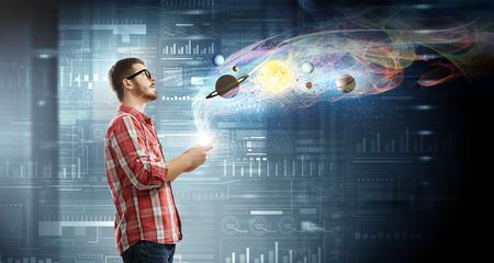 futuristic interior: Young man in casual with tablet in futuristic interior