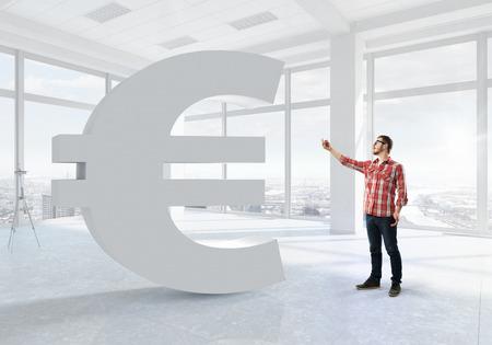 futuristic interior: Young man in checked shirt using tablet in futuristic interior Stock Photo