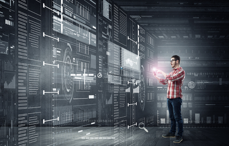 futuristic: Young man in casual with tablet in futuristic interior