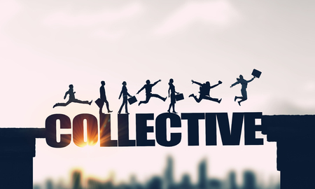 Silhouettes of businesspeople jumping over business conceptual word Reklamní fotografie